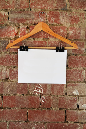 coat hanger: Add your message Blank retail sign hanging on coat hanger