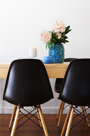 Contemporary interior dining table and retro chairs