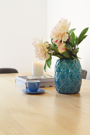Contemporary interior dining with vase flowers and coffee cup Stock Photo