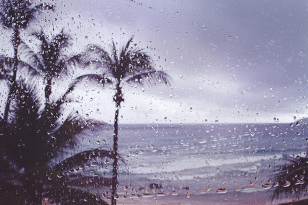 pane: Blur background tropical island storm rain on window pane Stock Photo