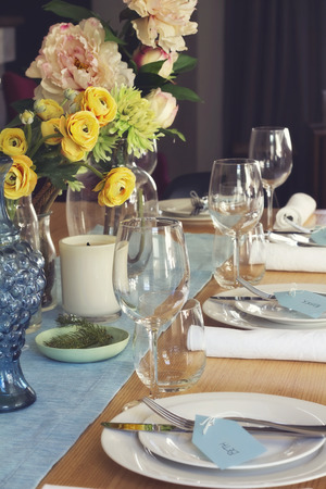 formal party: Formal table setting for lunch or dinner and flowers centrepiece