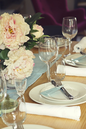 Centrepiece: Close up of formal table setting with flowers