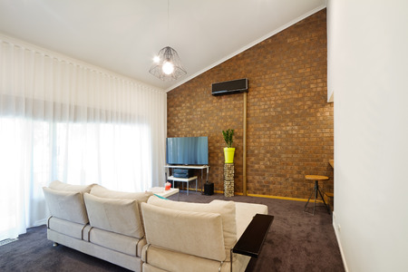architecture design: Renovated retro 70s architectural apartment with angeld roofline