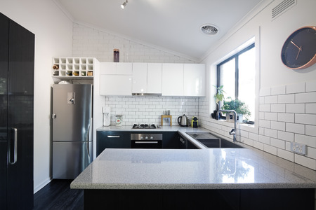 New black and white contemporary kitchen with subway tiles splashback Stock Photo - 35367974