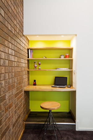 study room: Lime green feature wall study nook in contemporary living room Stock Photo