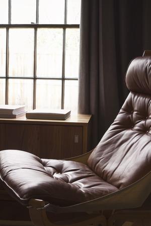 recliner: Vintage retro 70s danish tan leather hammock chair Stock Photo