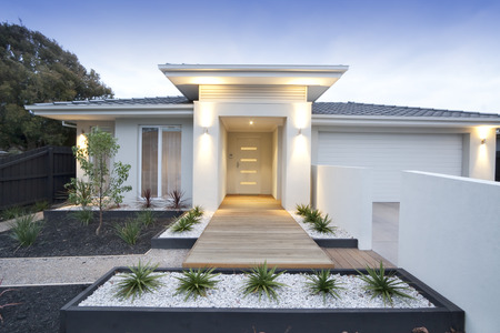 Facade and entry to a contemporary white rendered home in Australia Stok Fotoğraf