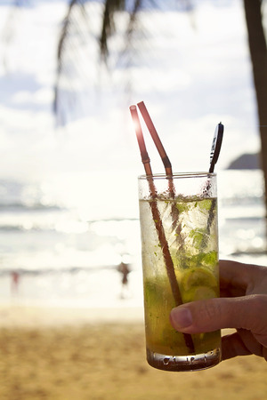 mocktail: Mohito cocktail with sun flare on vacation at the beach