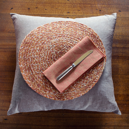 Overhead of home decor items cushion placemat napkin Stock Photo