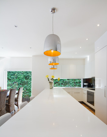 granite kitchen: Modern open plan Australian kitchen and dining renovation with island pendants Stock Photo