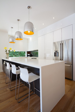 cor: Modern Australian kitchen renovation with waterfall stone island bench Stock Photo