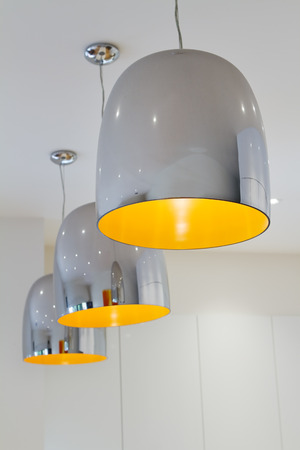 Three chrome and yellow contemporary kitchen pendant task lighting