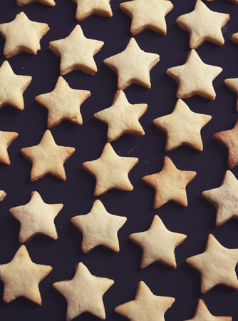 star shaped: Background of American Flag star shaped cookies biscuits vertical