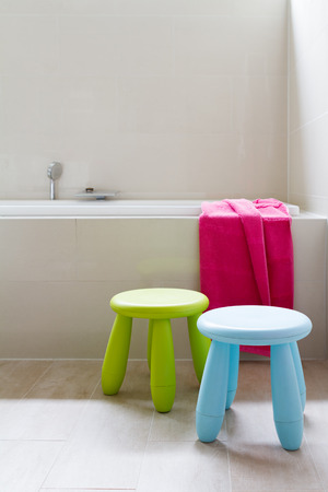 Contemporary designer bathroom renovation with kids decor items Stock Photo