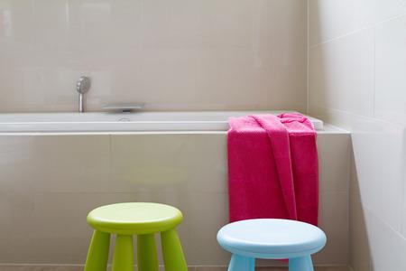 Contemporary designer bathroom renovation with kids decor items horizontal
