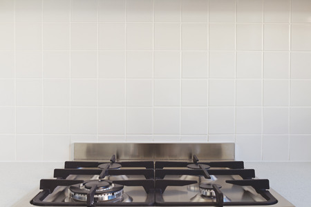 cooktop: Close up background of tile splashback in contemporary kitchen