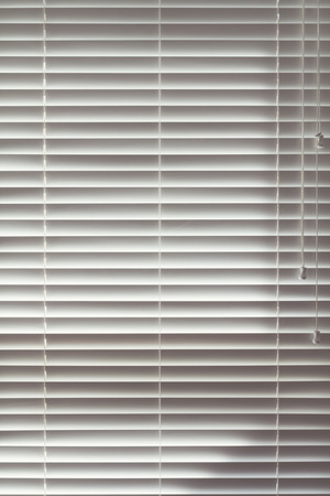 venetian blind: Background close up of closed wooden white venetian blinds Stock Photo