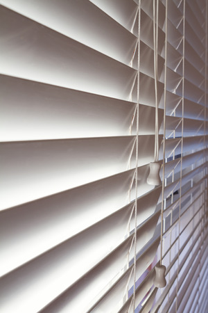 chattel: Close up background of white wooden venetian blinds in a modern home Stock Photo