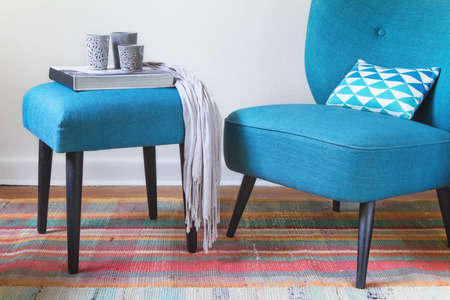 mid: Retro teal armchair and ottoman decor items home interior horizontal Stock Photo
