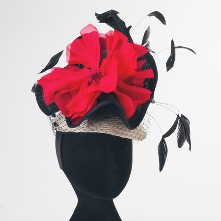 black hat: Red flower and black feathers races hat hand made Stock Photo