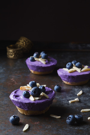 mini: Individual mini blueberry cheesecakes topped with blueberries and almonds
