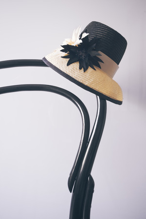 hand crafted: Ladies dress races hat sitting on a vintage black wooden chair