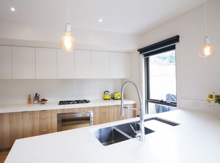 Modern kitchen with pendant lighting and sunken sink in island bench