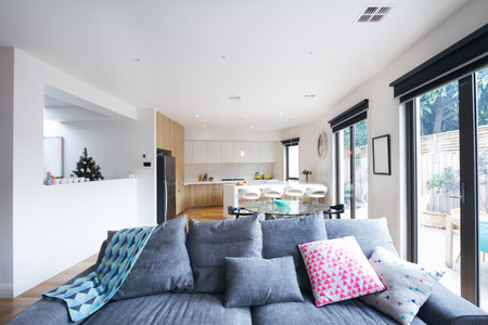Comfortable grey sofa in open plan living room in a contemporary home