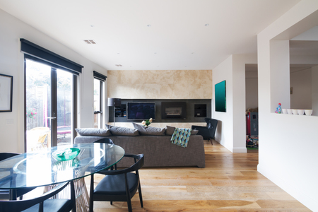 Modern dining table and open plan living room in Melbourne Australia