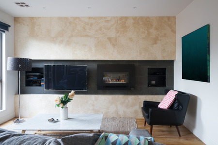 gas fireplace: Living room with wall mounted tv and gas fireplace in warm inviting home