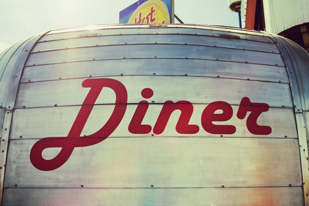 Diner red lettering on a metal van food truck Stock Photo