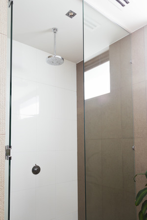 shower head: Close up of a contemporary shower and rain shower head in modern bathroom Stock Photo