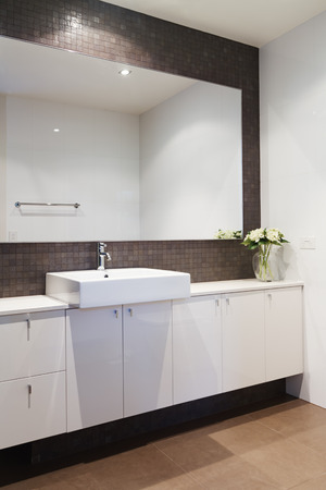 ensuite: Clean white bathroom with mosaic rustic splashback in contemporary architect designed home