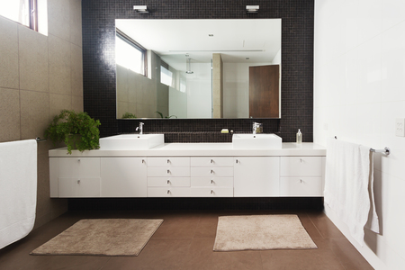 powder room: Double basin vanity and mirror in contemporary new large ensuite bathroom