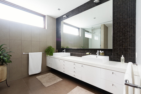 powder room: Black mosaic tiled splashback and double basin bathroom ensuite