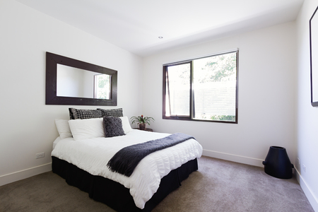 Contemporary decor in black and white themed show home bedroom interior