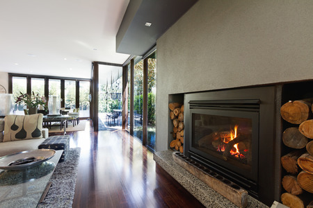decor residential: Cosy gas log fire in architect designed modern luxury open plan family home