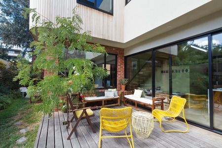 australian landscape: Outdoor patio deck on new renovation extension in contemporary Melbourne home Stock Photo