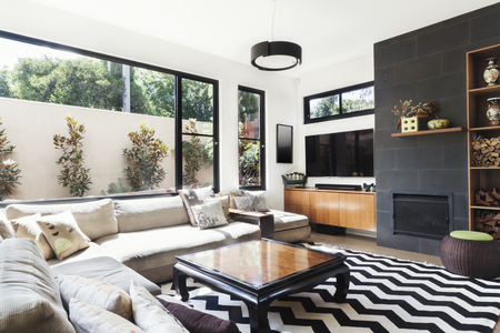 room accents: Monochrome living room with wood and grey tiling accents and chevron pattern rug