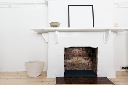fire place: White brick fire place in vintage styled living room interior Stock Photo