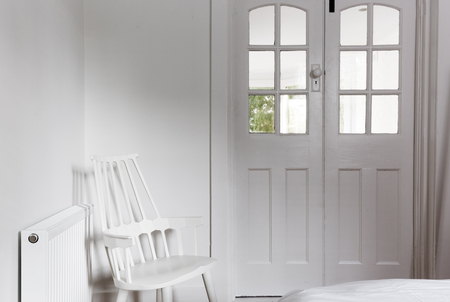 french doors: All white interior and decor in a cute baby bedroom