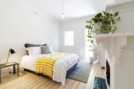 Luxury guest bedroom in vintage scandi styled Australian home Stock Photo