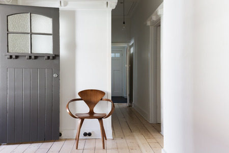 Simple decor of classic wooden chair in renovated apartment entry horizontal Stock Photo