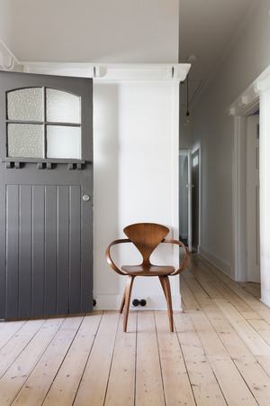 scandinavian: Simple decor of classic wooden chair in renovated apartment entry