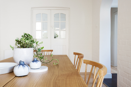 Close up details of scandi styled decor in contemporary dining room home interior Standard-Bild