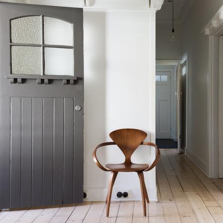 arredamento classico: Simple decor of classic wooden chair in renovated apartment entry square