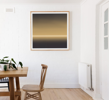 Yellow and black framed print on white wall in danish styled interior dining room