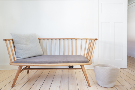 Bench seat feature chair in Danish styled white interior Stock Photo