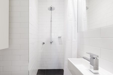 renovated: Horizontal verion of crisp white ensuite bathroom in renovated home