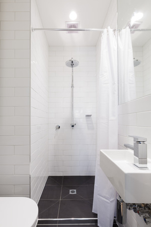 renovated: Small renovated white ensuite bathroom with rain shower